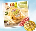 Douce France s'engage avec les éleveurs à produire un poulet aux céréales complètes.